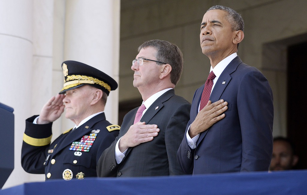 . (L to R) Chairman of the Joint Chiefs of Staff U.S. Army General Martin Dempsey, U.S. Defense Secretary Ash Carter and U.S. President Barack Obama attend a Memorial Day ceremony at Arlington National Cemetery May 25, 2015 in Arlington, Virginia. Obama, Chairman of the Joint Chiefs of Staff U.S. Army General Martin Dempsey and U.S. Defense Secretary Ash Carter honored fallen soldiers at Arlington on this Memorial Day.  (Photo by Olivier Douliery-Pool/Getty Images)