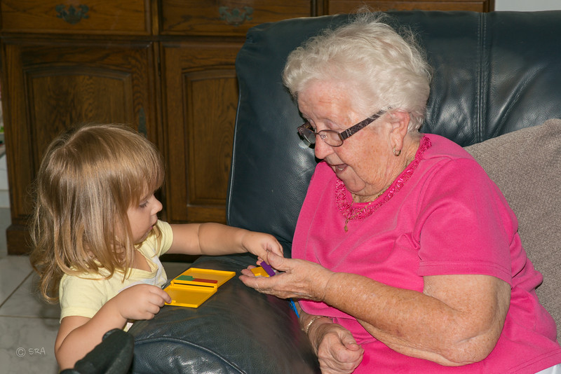 Paige showing Gran how to put the puzzle together.