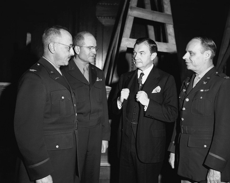 . Supreme Court Justice Robert H. Jackson (third from left), chief U.S. war crimes prosecutor, discusses plans for trials of persons accused of war crimes with three colonels in Nuernberg, Germany, Sept. 28, 1945, where the trials are expected to start about November 1. From Left to right are: Col. B. C. Andrus, in charge of the prison and prisoners at Nuernberg; Col. Robert G. Storey, chief of the documents section of the war crimes commission, Jackson, and Col. John Harlen Amen, head of the interrogation force of the war crimes commission. (AP Photo/William C. Allen)