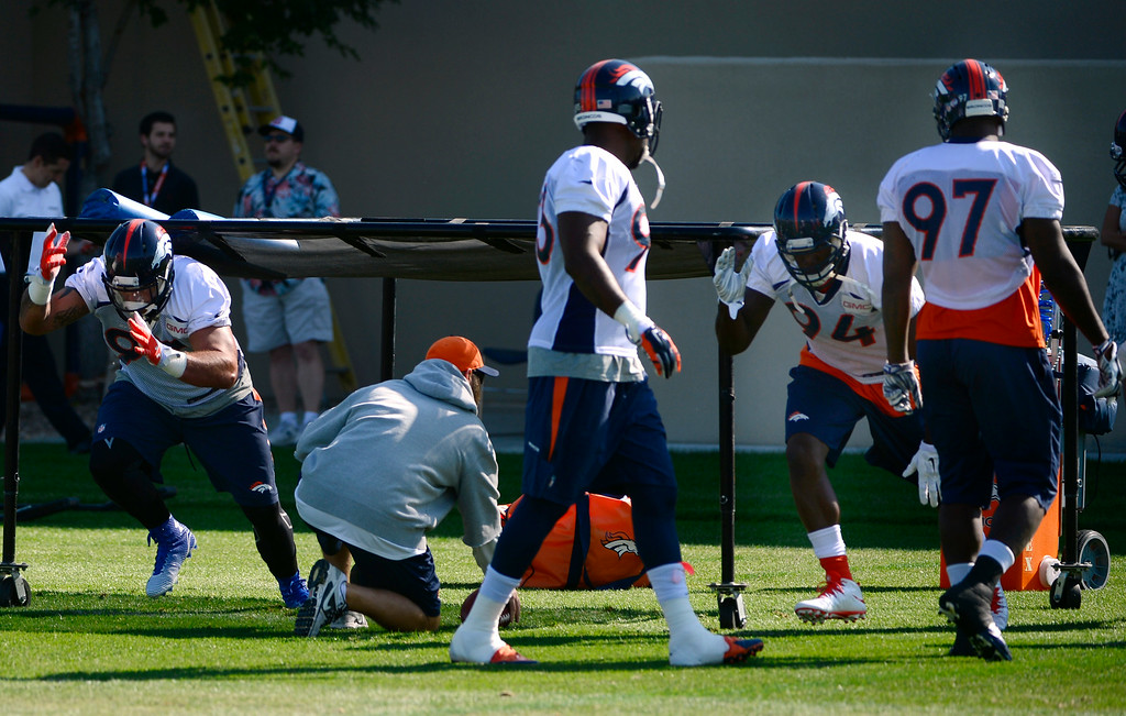 . The Broncos defense run through drills during practice. The Denver Broncos practice at Dove Valley on Monday, Sept. 1, 2014 in preparation for their season opener against the Indianapolis Colts on Sunday night. (Kathryn Scott Osler/The Denver Post)