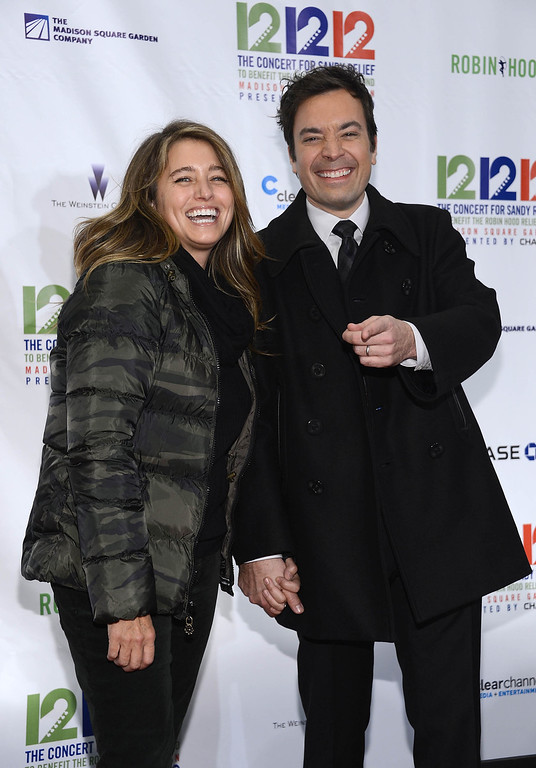 """. NEW YORK, NY - DECEMBER 12:  Nancy Fallon (L) and Jimmy Fallon attend \""""12-12-12\"""" a concert benefiting The Robin Hood Relief Fund to aid the victims of Hurricane Sandy presented by Clear Channel Media & Entertainment, The Madison Square Garden Company and The Weinstein Company at Madison Square Garden on December 12, 2012 in New York City.  (Photo by Dimitrios Kambouris/Getty Images)"""