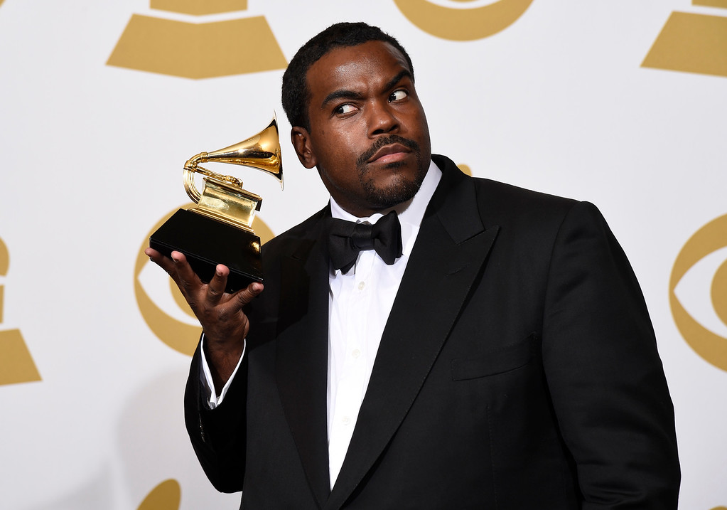 ". Rodney Jerkins poses in the press room with the award for record of the year for ""Stay With Me\"" at the 57th annual Grammy Awards at the Staples Center on Sunday, Feb. 8, 2015, in Los Angeles. (Photo by Chris Pizzello/Invision/AP)"