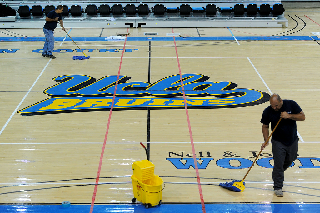 . Cleanup crew mops the floor at UCLA\'s Pauley Pavilion, Wednesday, July 30, 2014. (Photo by Michael Owen Baker/Los Angeles Daily News)