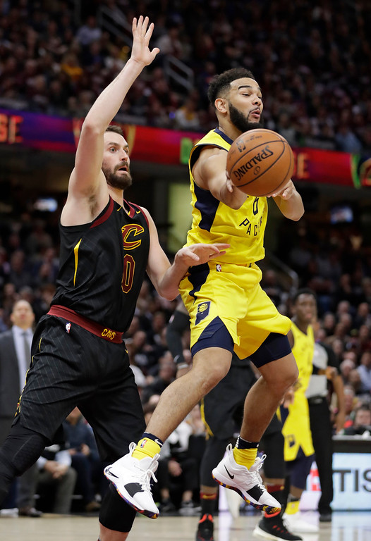 . Indiana Pacers\' Cory Joseph, right, passes the ball in front of Cleveland Cavaliers\' Kevin Love during the second half of Game 2 of an NBA basketball first-round playoff series Wednesday, April 18, 2018, in Cleveland. The Cavaliers won 100-97. (AP Photo/Tony Dejak)