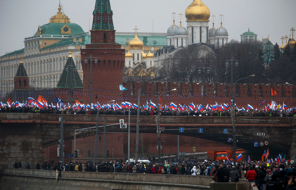 . People with Russian national flags march in memory of opposition leader Boris Nemtsov who was gunned down on Friday, Feb. 27, near the Kremlin, as they protest against his death in Moscow, Russia, Sunday, March 1, 2015.  Thousands converged Sunday in central Moscow to mourn veteran liberal politician Boris Nemtsov, whose killing on the streets of the capital has shaken Russiaís beleaguered opposition.  (AP Photo/Denis Tyrin)