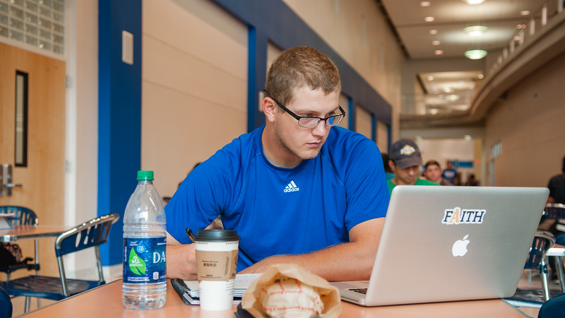 Brian Allec studies in Island Hall for his Health Care Finance class.