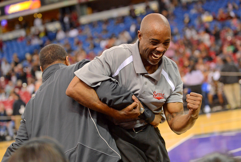 . Serra High School assistant coach William Hailey celebrates their victory over Salesian High during the Division IV 2013 CIF State Basketball Championships at Sleep Train Arena, in Sacramento, Ca March 23, 2013.(Andy Holzman/Los Angeles Daily News)
