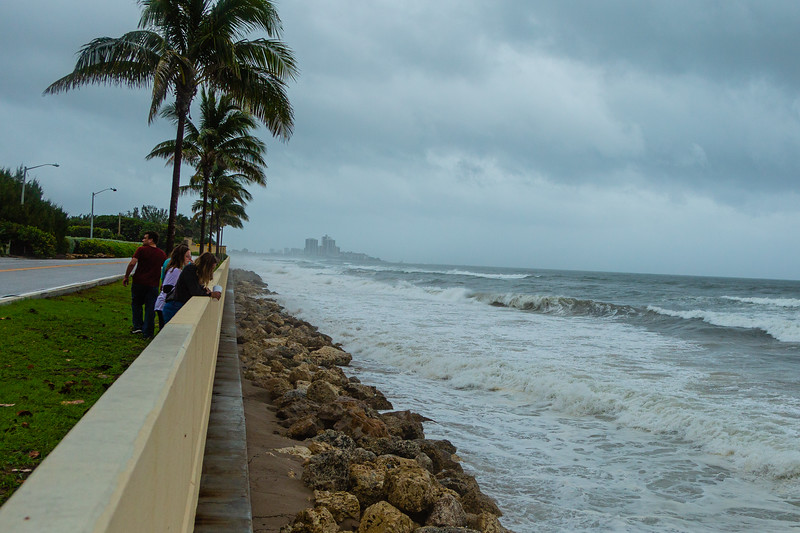 A family watches the waves break on the seawall on North Ocean Blvd on Palm Beach ahead of Hurricane Dorian side-swiping Florida's east coast on Labor Day, Monday, September 2, 2019. [JOSEPH FORZANO/palmbeachpost.com]