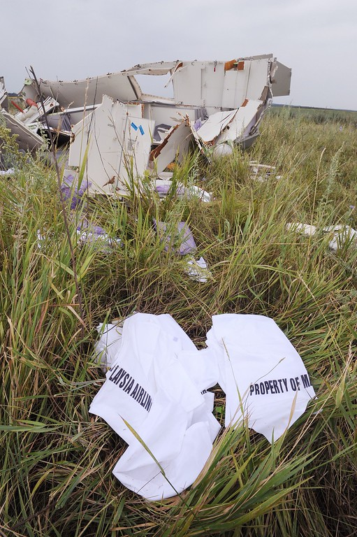 . Pieces of wreckage of the Malaysia Airlines flight MH17 are pictured on July 18, 2014 in Shaktarsk, the day after it crashed. Flight MH17 from Amsterdam to Kuala Lumpur, which US officials believe was hit by a surface-to-air missile over Ukraine, killing all 298 people on board.  AFP PHOTO / DOMINIQUE FAGET/AFP/Getty Images