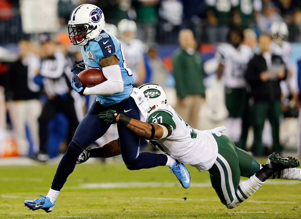 . New York Jets strong safety Yeremiah Bell (37) brings down Tennessee Titans wide receiver Nate Washington (85) in the first quarter of an NFL football game, Monday, Dec. 17, 2012, in Nashville, Tenn. (AP Photo/Joe Howell)