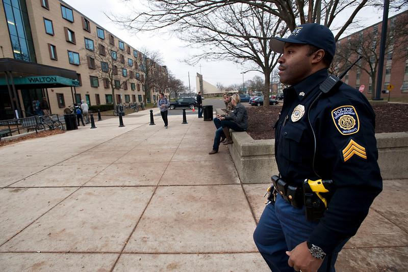 Eastern Michigan University police Sergeant Mathias Buckson does a routine patrol on the EMU campus on Nov 21, 2013.