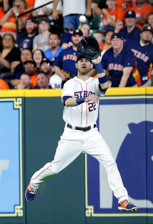 . Houston Astros right fielder Josh Reddick (22) makes the catch to end the seventh inning on the hit by Cleveland Indians\' Melky Cabrera during a baseball game, Sunday, May 20, 2018, in Houston. (AP Photo/Michael Wyke)