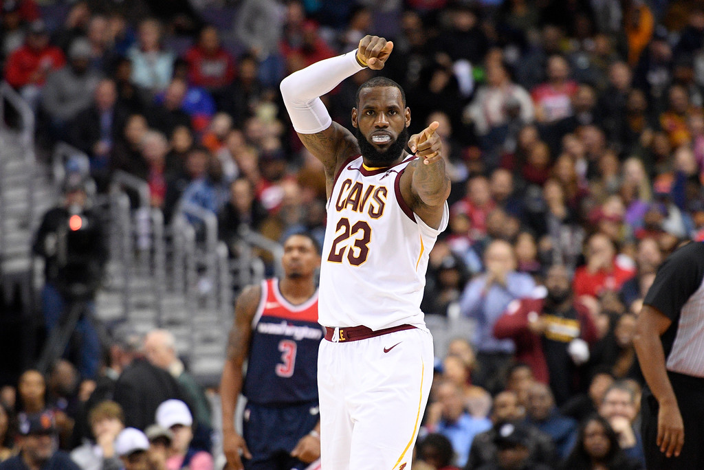 . Cleveland Cavaliers forward LeBron James (23) gestures after scoring during the second half of an NBA basketball game as Washington Wizards guard Bradley Beal (3) looks on, Sunday, Dec. 17, 2017, in Washington. (AP Photo/Nick Wass)