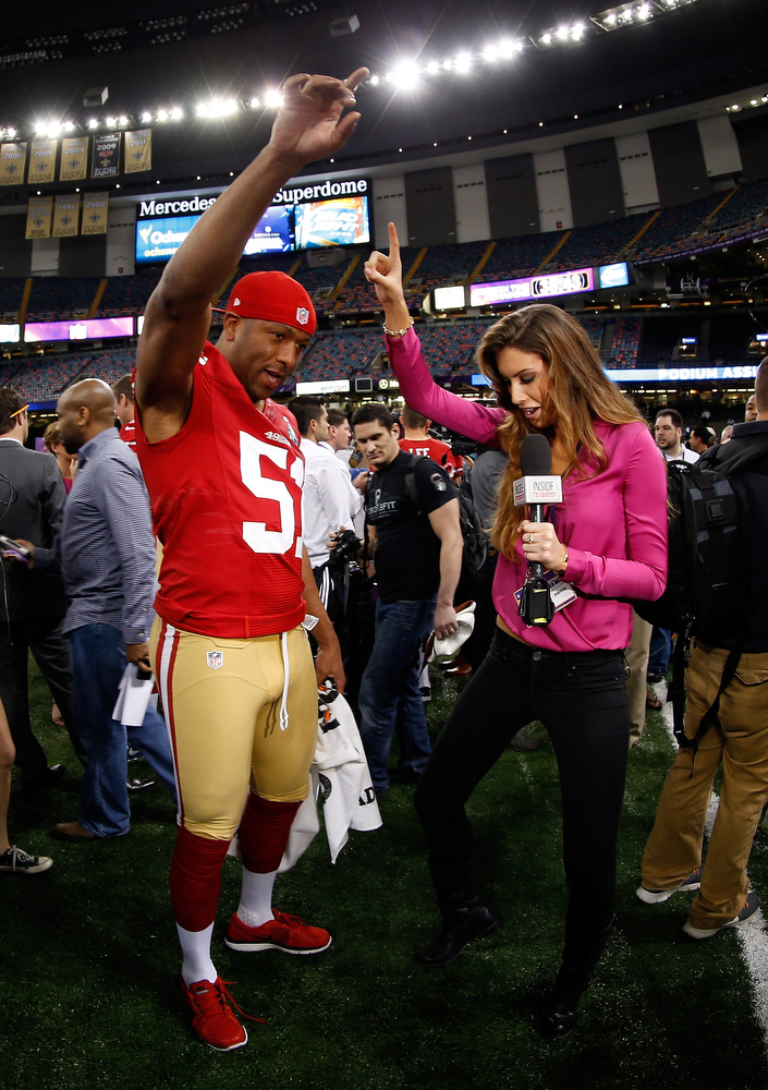 Description of . Clark Haggans #51 of the San Francisco 49ers and Katherine Webb of 'Inside Edition' dance during Super Bowl XLVII Media Day ahead of Super Bowl XLVII at the Mercedes-Benz Superdome on January 29, 2013 in New Orleans, Louisiana. The San Francisco 49ers will take on the Baltimore Ravens on February 3, 2013 at the Mercedes-Benz Superdome.  (Photo by Chris Graythen/Getty Images)