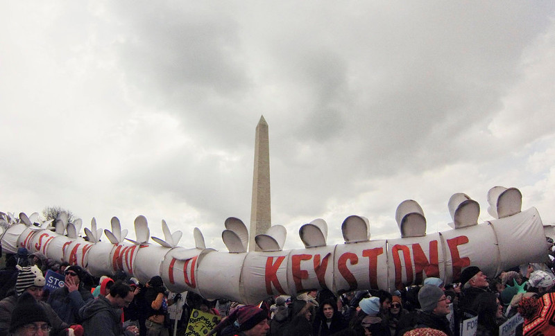 . Demonstrators carry a replica of a pipeline during a march against the Keystone XL pipeline in Washington, February 17, 2013. A small group of activists and celebrities protested in front of the White House to put pressure on Obama to reject the controversial proposed crude oil pipeline. Among the 48 protesters arrested and released on $100 bail were actress Daryl Hannah and environmentalist Robert F. Kennedy Jr. and his son Conor Kennedy, said Maggie Kao, spokeswoman for the Sierra Club. REUTERS/Richard Clement