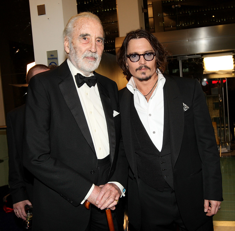 . Actors Johnny Depp (R) and Sir Christopher Lee attend the Royal World Premiere of \'Alice In Wonderland\' at Odeon Leicester Square on February 25, 2010 in London, England. (Photo by Claire R Greenway/Getty Images for Disney)