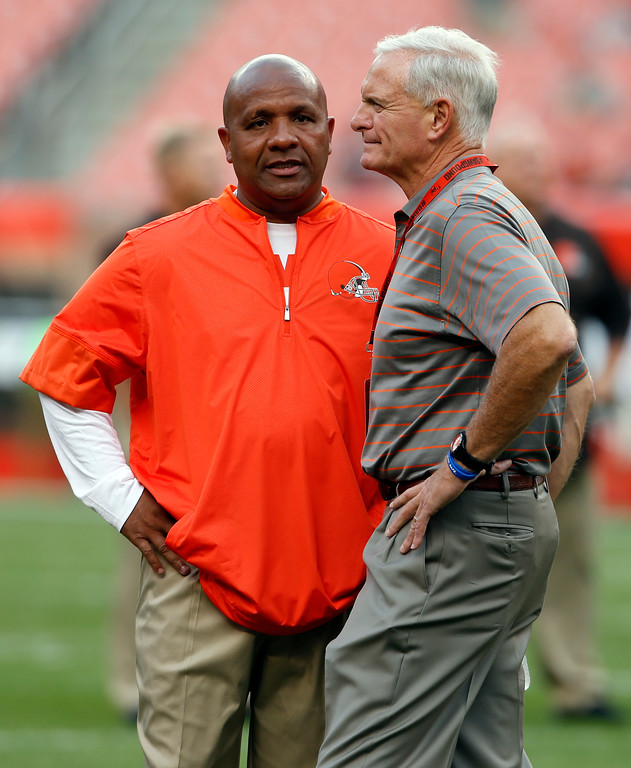 . Cleveland Browns head coach Hue Jackson, left talks with owner Jimmy Haslam before an NFL preseason football game between the New Orleans Saints and the Cleveland Browns, Thursday, Aug. 10, 2017, in Cleveland. (AP Photo/Ron Schwane)