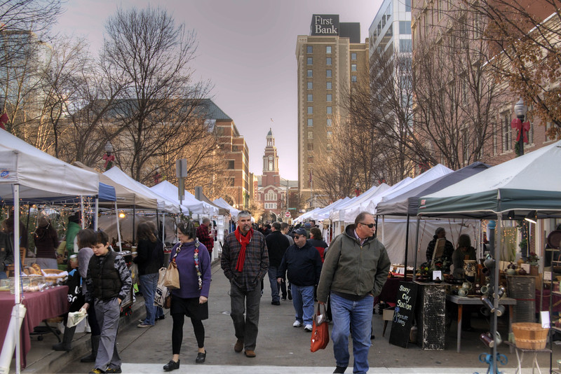 Shoppers explore dozens of vendor tents during the Holiday Market at Market Square in Knoxville, TN on Saturday, December 13, 2014. Copyright 2014 Jason Barnette