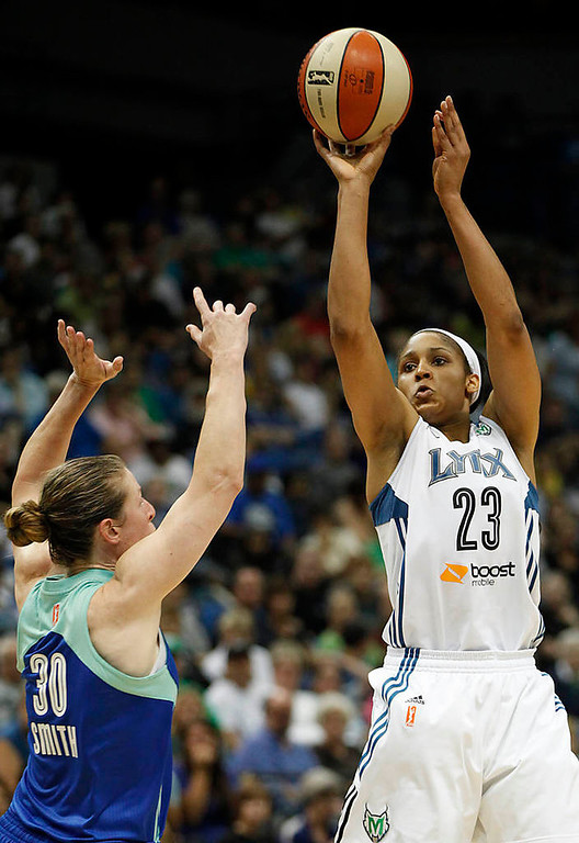 . Minnesota Lynx forward Maya Moore (23) takes a shot against New York Liberty guard Katie Smith (30) in the second half of a WNBA basketball game, Sunday, Aug. 18, 2013, in Minneapolis. The Lynx won 88-57 and Moore scored  28points. (AP Photo/Stacy Bengs)