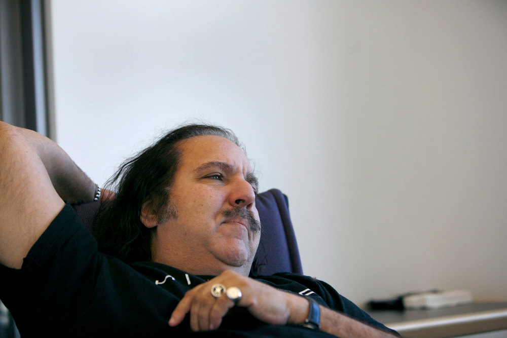Description of . Adult film star Ron Jeremy pauses during an interview with Reuters in New York in this February 7, 2007 file photo. Jeremy, one of the porn industry's biggest stars, was in intensive care and undergoing surgery for an aneurysm near his heart in Los Angeles, his manager said on January 30, 2013. REUTERS/Brendan McDermid/Files