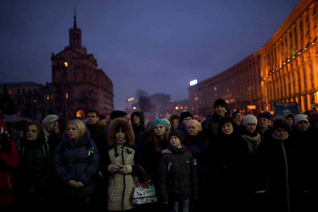 . People wait for the funeral of anti-Yanukovych protester Bailuk Alexander, 40, killed in a recent clash with riot police in Kiev\'s Independence Square, Ukraine, Friday, Feb. 28, 2014. Official reports say 82 people were killed in severe clashes between opposition activists and riot police. (AP Photo/Emilio Morenatti)