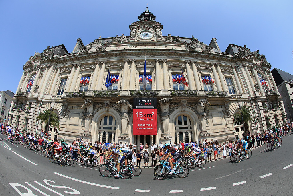. TOURS, FRANCE - JULY 12: Riders pass by the Hotel De Ville as they start stage thirteen of the 2013 Tour de France, a 173KM road stage from Tours to Saint-Amand-Montrond on July 12, 2013 in Tours, France.  (Photo by Doug Pensinger/Getty Images)
