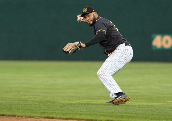 05/03/19 Wesley Bunnell | Staff The New Britain Bees home opener vs the Somerset Patriots on Friday night at New Britain Stadium. Second baseman Jonathan Galvez (10) fields a ball on the grass between first and second.