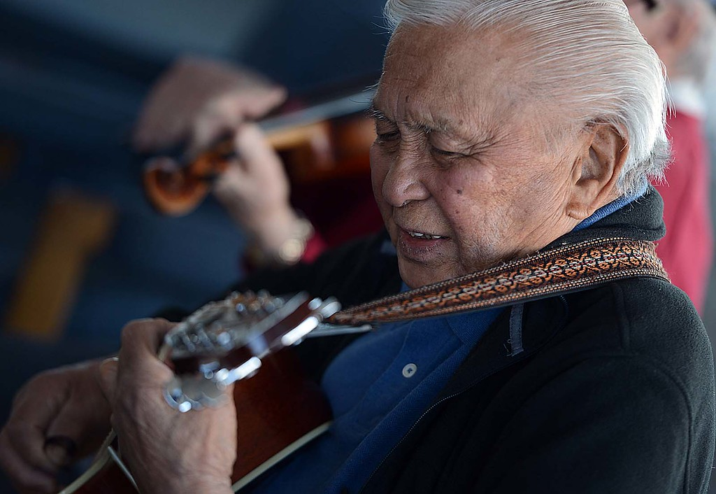 ". Conrad Adayan, 87, plays guitar with a group of fellow World War II Veterans. The Redlands Airport Philharmonic gather each Wednesday in the lobby of the Redlands Airport to share stories, coffee, donuts and ""Just to jam.\"" Says keyboardist Lew Lemon, 87. (Staff photo by Rick Sforza/Redlands Daily Facts)"