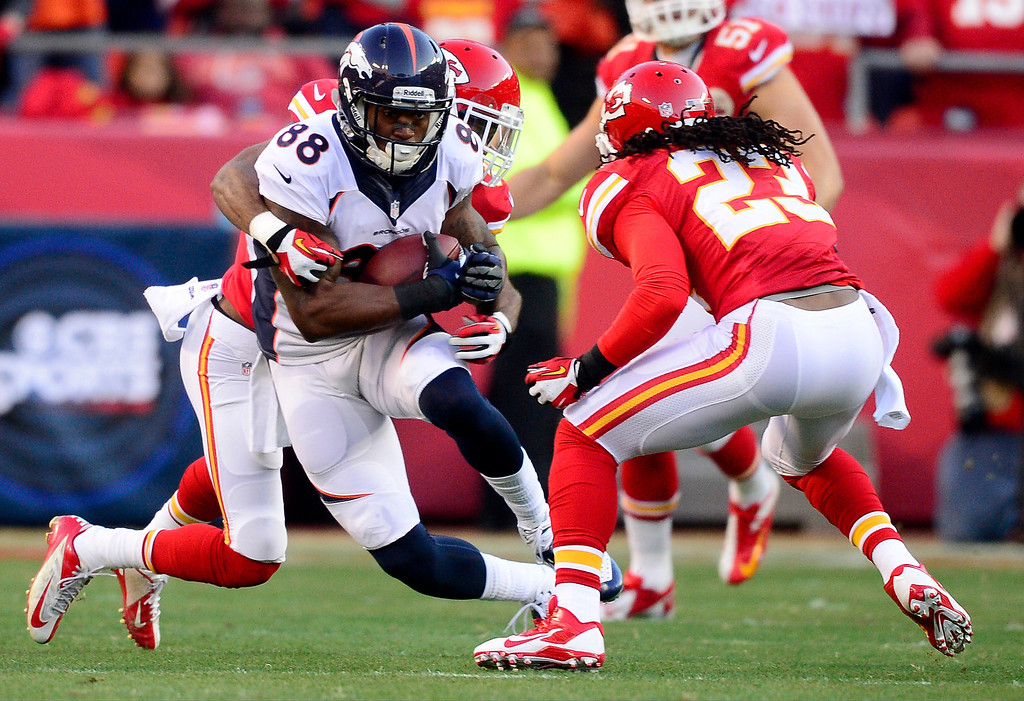 . Demaryius Thomas (88) of the Denver Broncos is tackled by Marcus Cooper (31) of the Kansas City Chiefs and Kendrick Lewis (23) during the first half of action at Arrowhead Stadium.   (Photo by AAron Ontiveroz/The Denver Post)