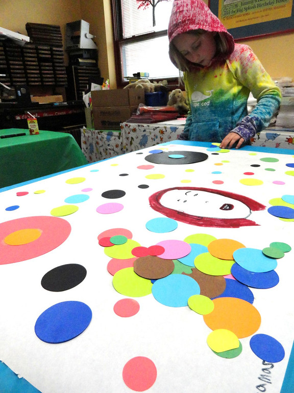 . Claire Gibbons carefully places each polka dot in her artwork. (Courtesy Mentor Public Library)