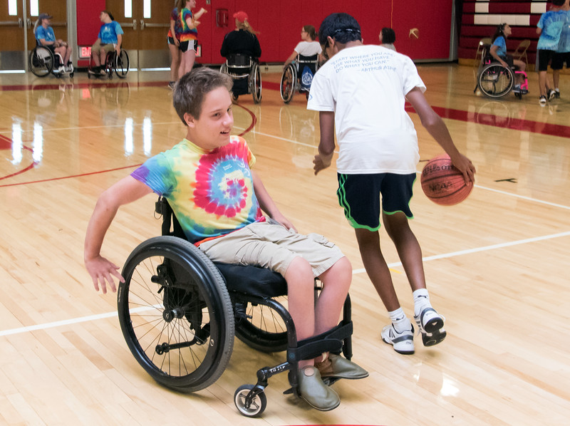 08/08/18  Wesley Bunnell | Staff  The Hospital for Special Care is holding its Ivan Lendl Adaptive Sports Camp this week at Berlin High School.  The camp is held every summer for youth with physical disabilities ages 6-19. Joseph Johnston from Newark NJ guards volunteer Utsav Subranani as he dribbles the basketball around the court.