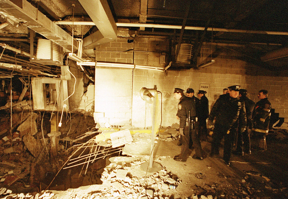 . New York City police and firefighters inspect the bomb crater inside the World Trade Center on February 27, 1993, one day after the fatal attack by an Islamic faction.  Six people were killed and more than 1,000 injured in the bombing.  (AP Photo/Richard Drew)