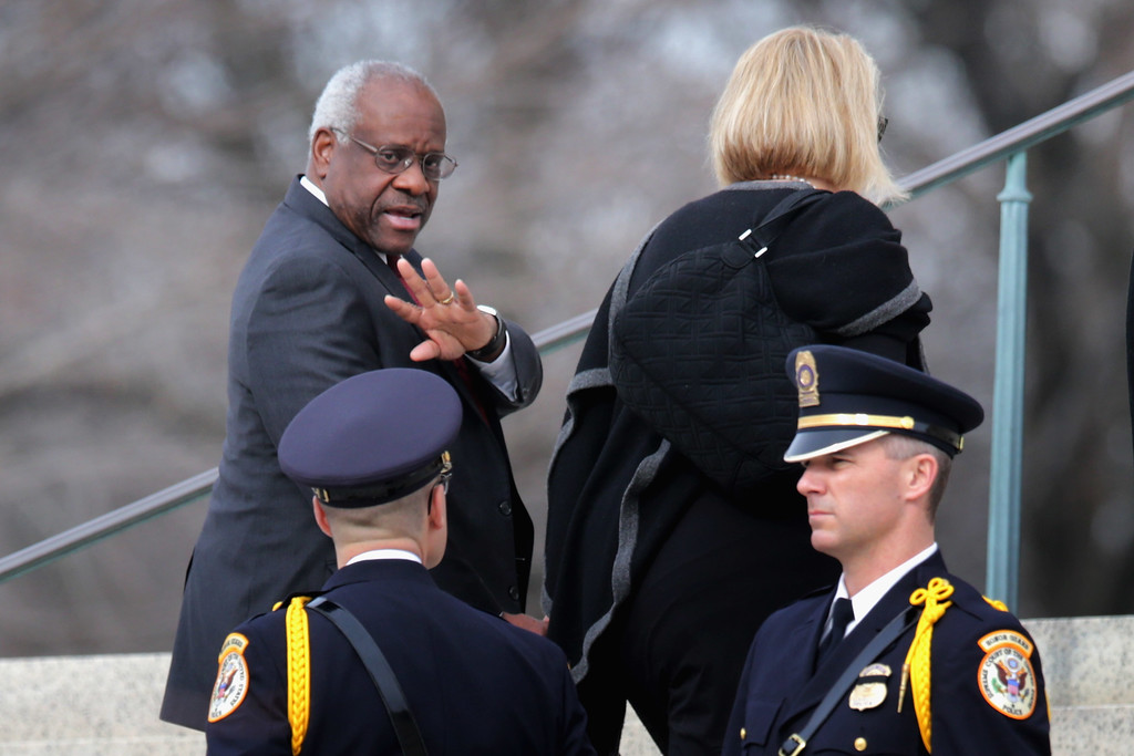 . U.S. Supreme Court Associate Justice Clarence Thomas and his wife Virginia Thomas arrive for the funeral for fellow Associate Justice Antonin Scalia at the the Basilica of the National Shrine of the Immaculate Conception February 20, 2016 in Washington, DC. Scalia, who died February 13 while on a hunting trip in Texas, layed in repose in the Great Hall of the Supreme Court on Friday and his funeral service will be at the basillica today.  (Photo by Chip Somodevilla/Getty Images)