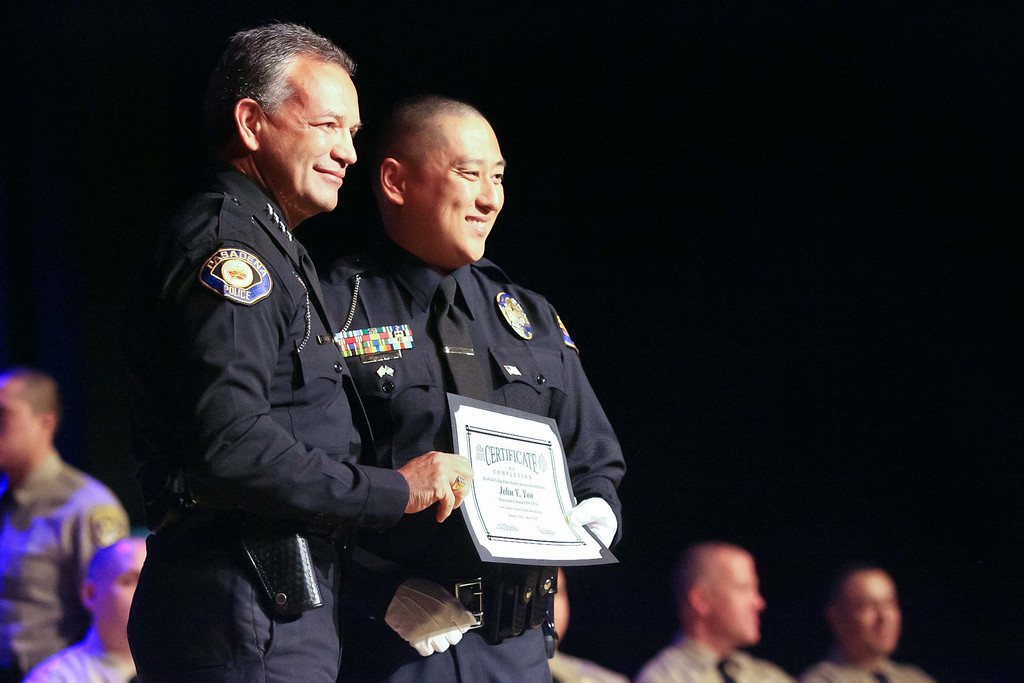 . Rio Hondo Police Academy graduate John Yoo, posses with Pasadena Police Chief Phillip Sanchez for family photos. This is the first class to graduate from the Academy since shutting down in 2010. The graduation took place Saturday July 13, 2013 at the Rio Hondo College Wray Theatre. (Correspondent photo by Chris Burt)