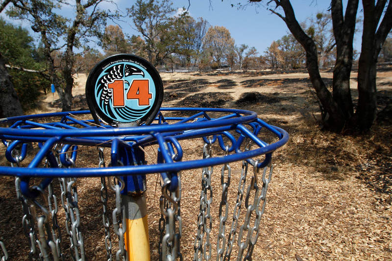 Behind the Peregrine Point Disc Golf Course hole No. 14, the blackened second fairway is seen Tuesday, Aug. 14, 2018, in Chico, California. Much of the course was part of the 962 acres burned by the Stoney Fire in July. (Dan Reidel -- Enterprise-Record)