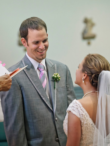 Bride and Groom smiling at the altar.jpg