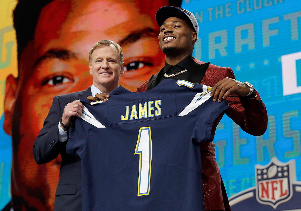 . Commissioner Roger Goodell, left, presents Florida State\'s Derwin James with his Los Angeles Chargers jersey during the first round of the NFL football draft, Thursday, April 26, 2018, in Arlington, Texas. (AP Photo/David J. Phillip)