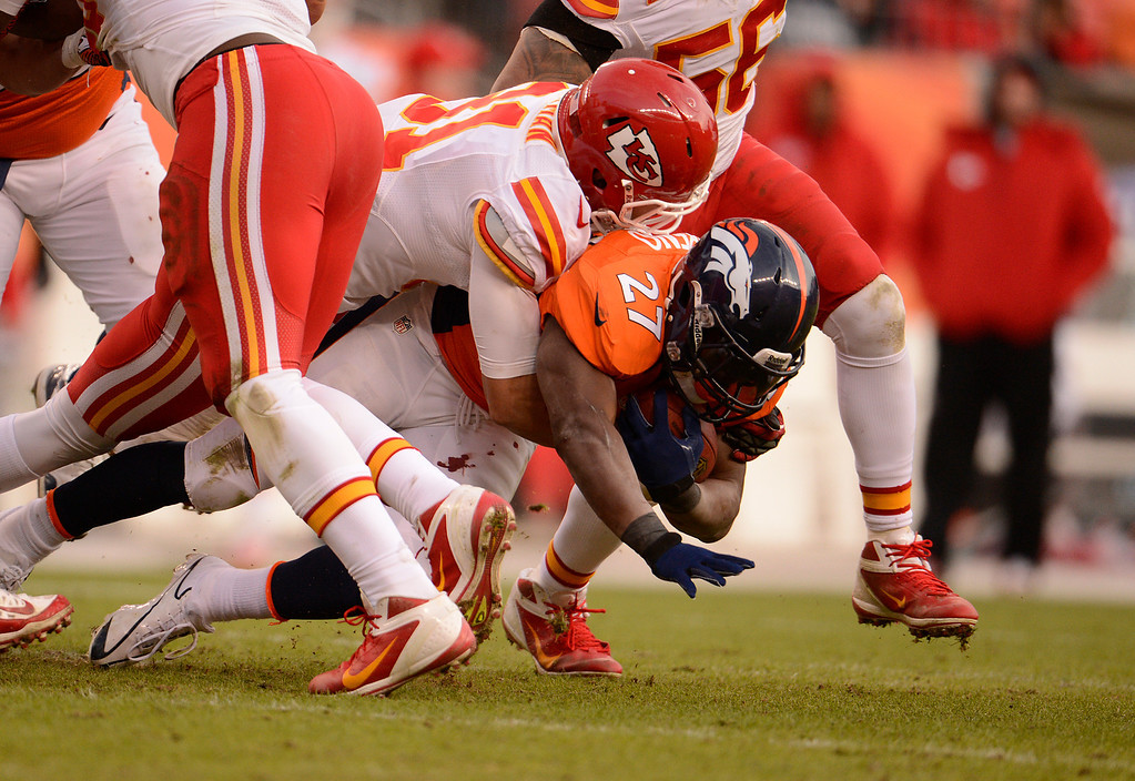 . Denver Broncos running back Knowshon Moreno (27) is tackled in the third quarter as the Denver Broncos took on the Kansas City Chiefs at Sports Authority Field at Mile High in Denver, Colorado on December 30, 2012. John Leyba, The Denver Post
