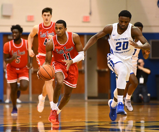 1/4/2020 Mike Orazzi | StaffrCentral Connecticut State University's Stephane Ayangma (20) and Saint Francis University's Isiah Blackman (11) during Saturdays mens basketball game in New Britain. r
