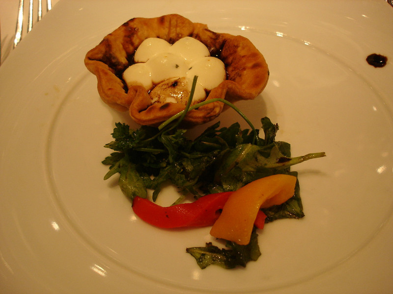 Baked farm goat cheese tart with roasted red peppers and balsamic