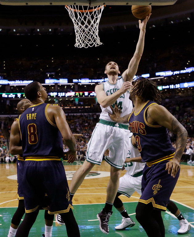 . Boston Celtics center Tyler Zeller shoots between Cleveland Cavaliers forwards Channing Frye, left, and Derrick Williams, right, during the second half of Game 2 of the NBA basketball Eastern Conference finals, Friday, May 19, 2017, in Boston. (AP Photo/Elise Amendola)