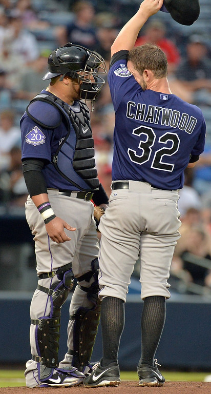 . Colorado Rockies catcher Yorvit Torrealba (8) confers with Colorado Rockies starting pitcher Tyler Chatwood (32) in the 3rd inning against the Atlanta Braves at Turner Field in Atlanta, Georgia, Wednesday, July 31, 2013. (Hyosub Shin/Atlanta Journal-Constitution/MCT)