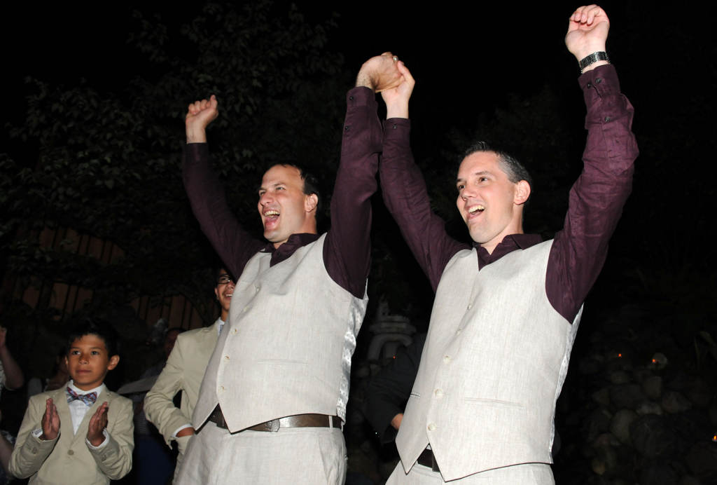 . Bradley Weber, left, and husband Ryan Pfeifle celebrate as officiant Annamarie Ronning reads that they are legally married after midnight on Aug. 1, 2013, at their home in Eden Prairie. (Pioneer Press: Sherri LaRose-Chiglo)