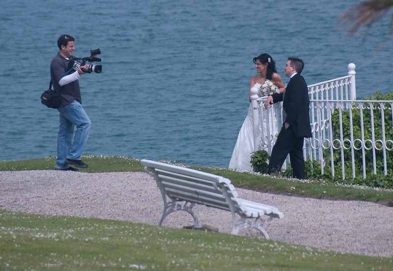 Newlyweds having their photoshoot along the beach in San Sebastian, Spain