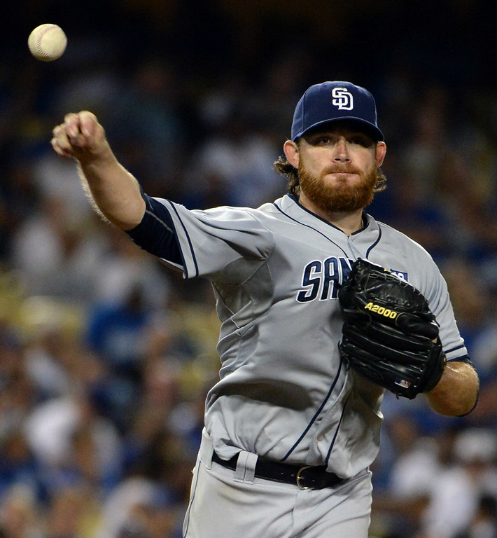 . San Diego Padres starting pitcher Ian Kennedy throws to first base in the seventh inning of a Major league baseball game against the Los Angeles Dodgers on Saturday, July 12, 2014 in Los Angeles.   (Keith Birmingham/Pasadena Star-News)