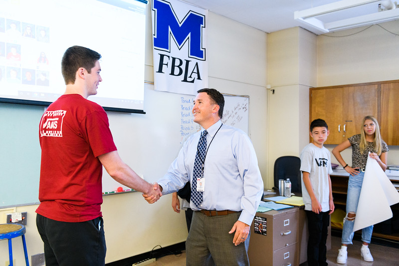 Business class teacher Brad Lomax teaches his students how to shake hands and properly introduce themselves. Back to school day at McNary High School on Wednesday, September 4, 2019 in Keizer, Ore.