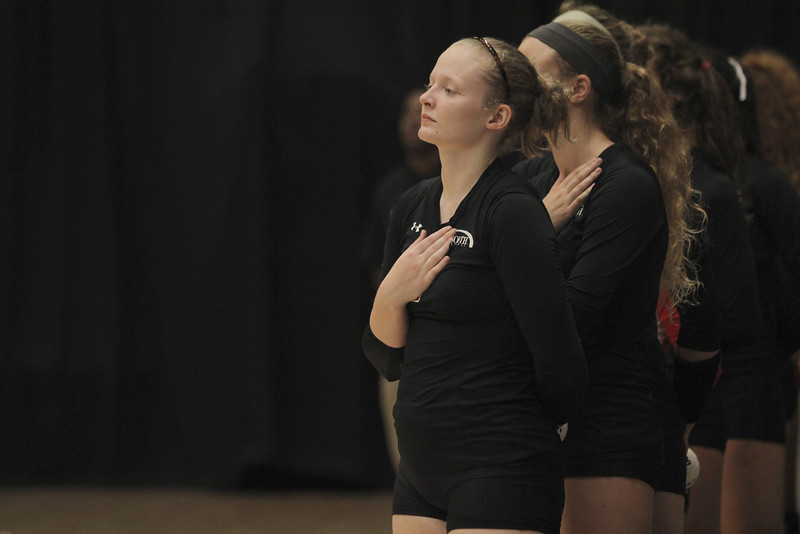 Heather Feldman and the GWU Volleyball team show respect as the National Anthem was sung.