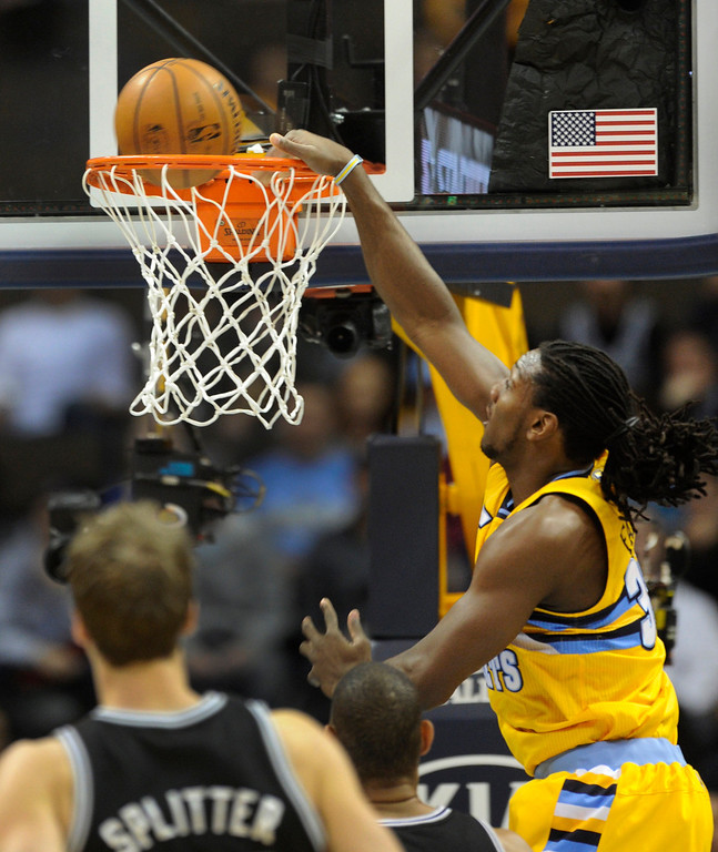 . Denver forward Kenneth Faried (35) slammed the ball through the hoop in the first half. The Denver Nuggets hosted the San Antonio Spurs at the Pepsi Center Tuesday night, December 18, 2012. Karl Gehring/The Denver Post