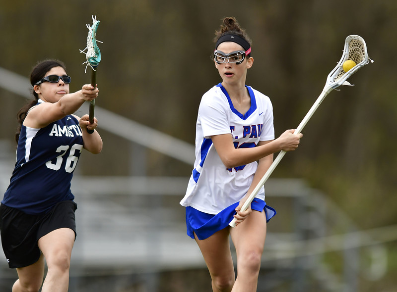 5/2/2019 Mike Orazzi   Staff St. Paul's Greta Panke (16) during Thursday's girls lacrosse with Amistad in Bristol.