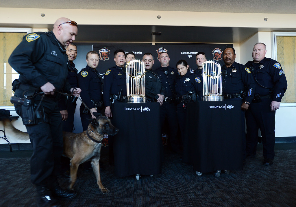 . Members of the Richmond Police Department pose with  the World Series Trophy as it makes a stop at the Richmond Memorial Auditorium in Richmond, Calif. on Monday, Jan. 14, 2013.  (Kristopher Skinner/Staff)